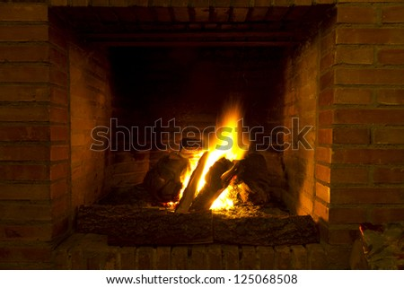 a fireplace in old house - stock photo
