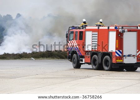 A firetruck is moving the fire. - stock photo