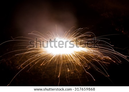 A firework, fire cracker rotating on the floor which is using during the traditional Diwali festival in India and also during  the occasion of new year,Christmas - stock photo
