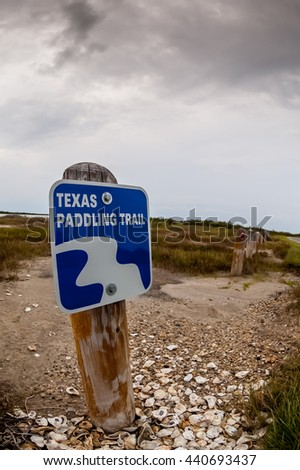 A fish eye shot of signage marking a paddling trail in Texas