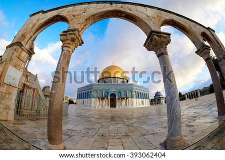 A fish eye view of Dome of the Rock in Masjidil Aqsa through an arch