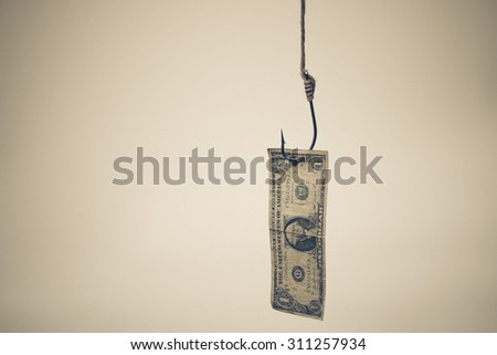 a fish hook with a dollar banknote - money trap concept - stock photo