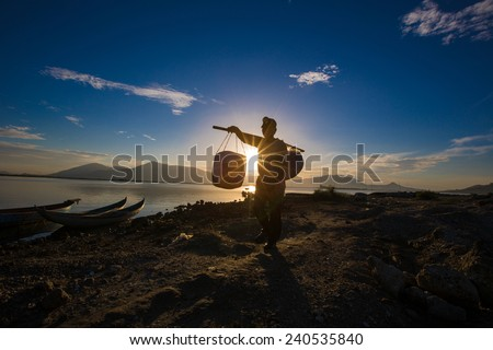 A fisherman come back home after fishing in the morning - stock photo
