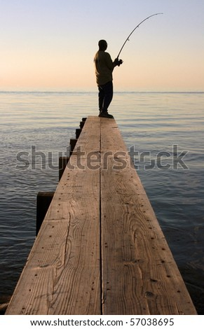 A fisherman on a dock in the Outer Banks, North Carolina - stock photo
