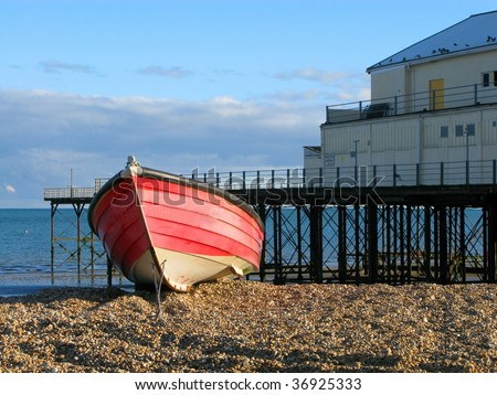A fisherman's boat by the pier at Bognor Regis - stock photo