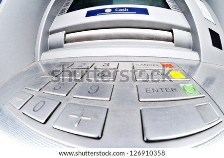 A fisheye view of the cash drawer of an ATM, cashpoint or cash dispenser. - stock photo