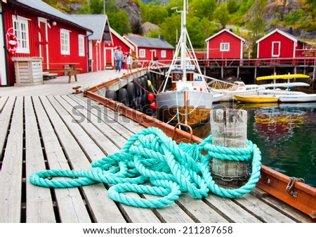 A fishing boat in a harbor in northern Norway - stock photo
