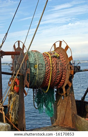 A fishing net on a boat in the harbor of Provincetown, Massachusetts - stock photo