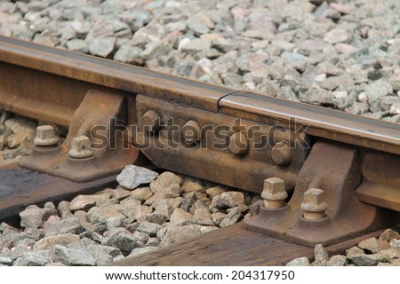 A Fishplate Connector on a Traditional Railway Track. - stock photo