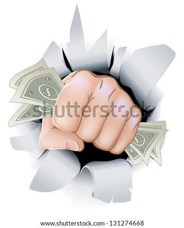 A fist full of paper money money, dollars, smashing through the background, or wall. - stock photo