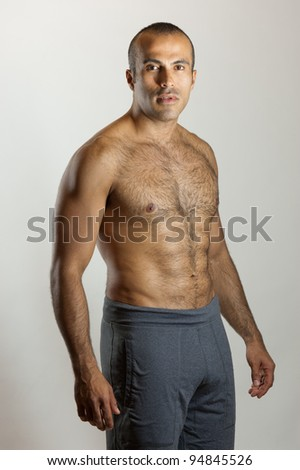 A  fit Latin Guy with a tough look - stock photo