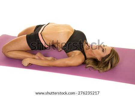 A fit woman doing a yoga stretch, bending her body back.