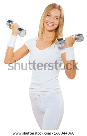 a fitness female holding two dumbbells and smiling