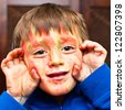 A five year old boy with face paint on - stock photo