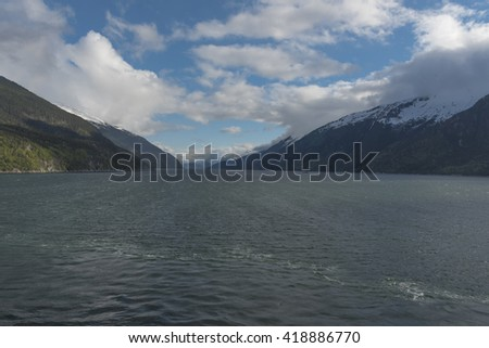 A Fjord with blue skies and white clouds in the background near Skagway, Alaska USA