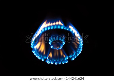 a flame burning on a gas stove in the kitchen - stock photo