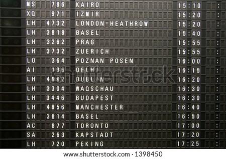 A flight information panel taken at the Frankfurt Airport. - stock photo