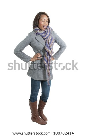 A flirting young Beautiful black African American Woman winking and smiling - stock photo