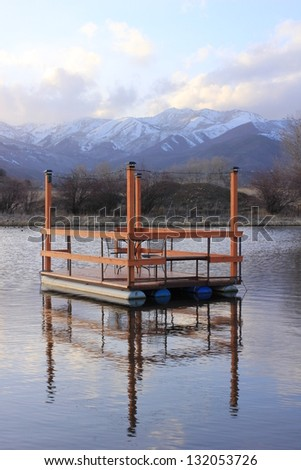 A floating dock with dining table and chairs in a lake in the Utah mountains & Floating Dock Dining Table Chairs Lake Stock Photo (Royalty Free ...