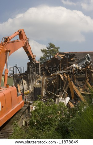 A flood damaged home in the Lakeview section of New Orleans as it is being torn down. - stock photo