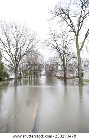 A flooded roadway in the Chicago area on a cloudy day. - stock photo