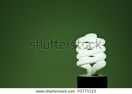 A florescent bulb symbolizing the saving energy of and money - stock photo
