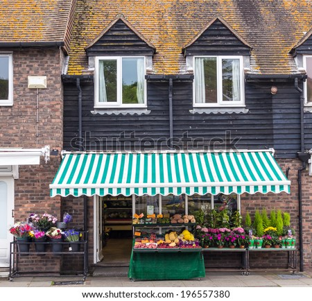 A flower shop opened in an old house, seen in Rye, Kent, UK. - stock photo