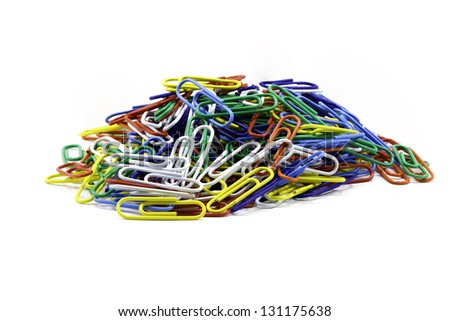 A Focus-stacked image containing a pile of colorful paper clips isolated against white with room for copy - stock photo