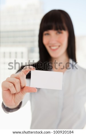 A focused shot on the business card as it is held by a business woman - stock photo