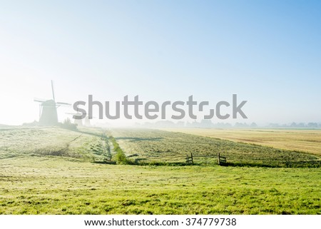 A foggy day in a typically Dutch landscape - stock photo