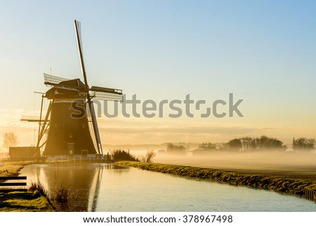 A foggy day in a typically Dutch landscape (Leidschendam) - stock photo