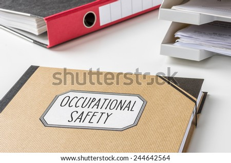 A folder with the label Occupational safety - stock photo