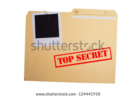 A folder with TOP SECRET stamped across the front and a blank photograph clipped to it - stock photo