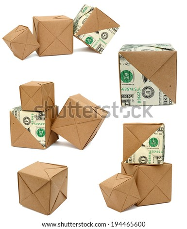 A folding origami cubes box with dollar - stock photo