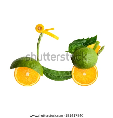 A food concept of a retro scooter Vespa made of fruits and vegs isolated on white. - stock photo