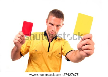 a football judge with yellow and red card - stock photo