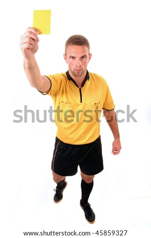 a football judge with yellow card - stock photo