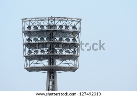 a football stadium floodlight with metal pole - stock photo