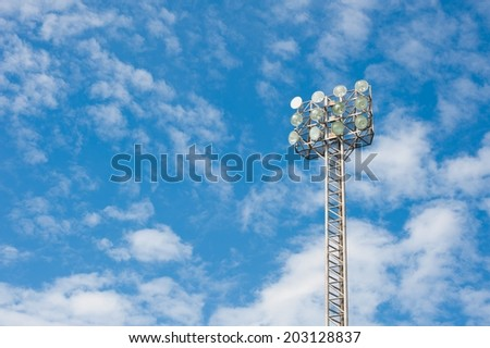 A football stadium sportlight with blue sky