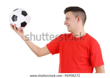 A footballer looking at a football side view on, isolated on white.