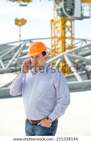 A foreman at the construction supervising the project.