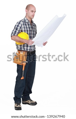 A foreman checking the plans. - stock photo