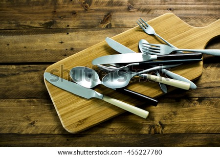 A fork and a knife and spoon - stock photo