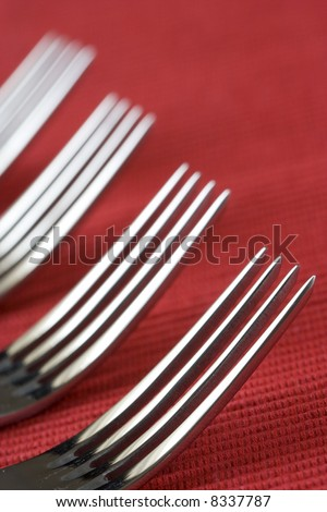 a fork perspective with a red background (soft and selective focus) - stock photo