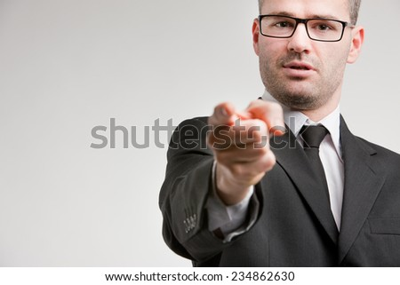 a formal businessman accuses you not to be enough responsible for your actions - stock photo