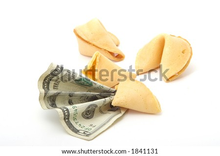 A fortune cookie predicts a positive financial future. - stock photo