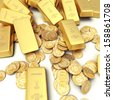 A fortune in gold ingots and coins - stock photo