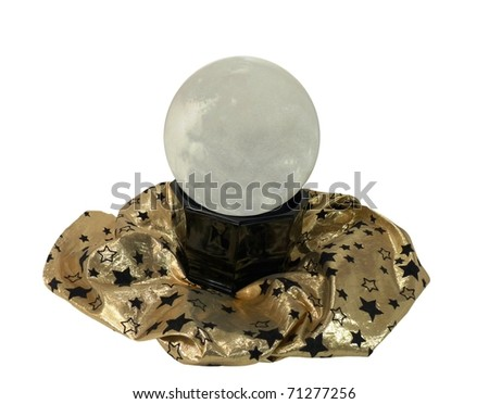 a fortune teller's crystal ball on a gold shimmery cloth with stars isolated on a pure white background