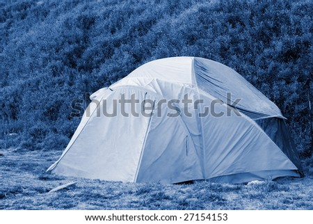 A forzen small tent in cold high moutain. - stock photo