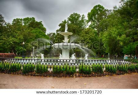 A fountain flows on a stormy day in Savannah, Georgia. - stock photo